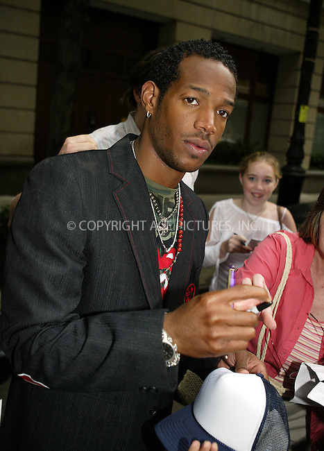 Marlon Wayans on 'Regis and Kelly Show' New York, June 19, 2004. Please byline: PHILIP VAUGHAN/ACE Pictures.   .. *** ***  ..All Celebrity Entertainment, Inc:  ..contact: Alecsey Boldeskul (646) 267-6913 ..Philip Vaughan (646) 769-0430..e-mail: info@nyphotopress.com