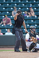 Home plate umpire Dane Poncsak makes a strike call during the Carolina League game between the Carolina Mudcats and the Winston-Salem Dash at BB&T Ballpark on June 1, 2019 in Winston-Salem, North Carolina. The Mudcats defeated the Dash 6-3 in game one of a double header. (Brian Westerholt/Four Seam Images)