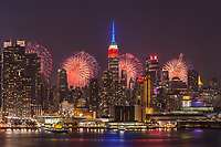WEEHAWKEN, NJ - JULY 4: The annual Macy's Fourth of July fireworks show lights the sky behind the Manhattan skyline on Tuesday, July 4, 2017 as seen from Weehawken, New Jersey across the Hudson River.
