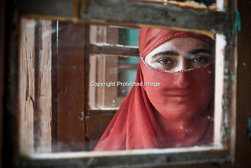 "Sahfiqa is not able to express in deep her feelings, but her hopeless words are full of sorrow: ""I don't expect my husband to get back. I don't hold any hope to see him again"". Farooq, her loved one, joint to the militancy on 1996, at August 6th the militants picked him up from home and never came back. According with human rights APDP organization, Farooq most likely might be buried at one of the mass graves in Kashmir, where those bodies are unidentified and unmarked. Dolipora village, Kupwara district, Indian administrated Kashmir."