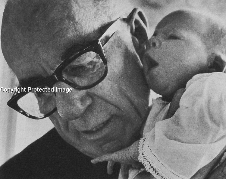 Benjamin Spock, American pediatrician (with his first granddaughter, Susannah)