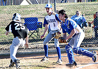 Westside Eagle Observer/MIKE ECKELS<br /> <br /> A Yellowjacket runner tries to escape a trap set up by Bulldog catcher Kevin Garcia (right) and pitcher Tyler Burchette (2) during the Decatur-Mulberry baseball game in Decatur March 6. The umpire ruled the runner out.
