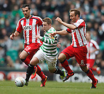 Kris Commons sandwiched by Manuel Pascali and Liam Kelly