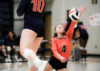 NWA Democrat-Gazette/CHARLIE KAIJO Rogers Heritage High School Brittney Ware (4) blocks during a volleyball game, Thursday, October 11, 2018 at Rogers Heritage High School in Rogers.