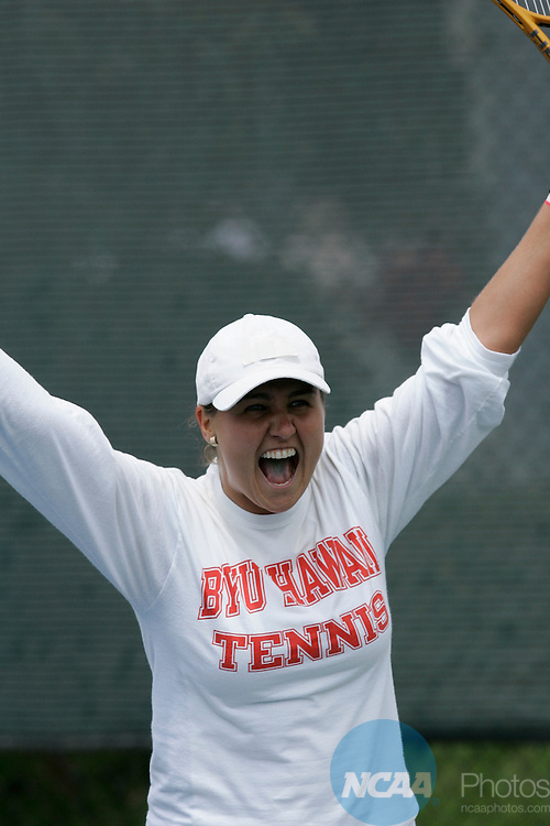 13 MAY 2006:  BYU-Hawaii's Ramona Husaru celebrates her win over Armstrong Atlantic State's Dziyana Nazaruk in women's Third Singles during the Division II Women?s Tennis Championship held at the Plaza Tennis Center in Kansas City, MO. BYU-Hawaii won the title.  Reed Hoffmann/NCAA Photos
