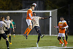 Alexander Hemmingsen (24) of the Clemson Tigers heads the ball away from Joey DeZart (14) of the Wake Forest Demon Deacons during first half action at Spry Soccer Stadium on November 8, 2017 in Winston-Salem, North Carolina.  The Demon Deacons defeated the Tigers 2-1.  (Brian Westerholt/Sports On Film)