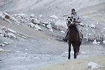 Ranger Temirbek Jandrbaev patrolling reserve on horseback, Sarychat-Ertash Strict Nature Reserve, Tien Shan Mountains, eastern Kyrgyzstan