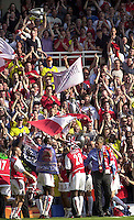 Photo. © Peter Spurrier/Intersport Images.15/05/2004  - 2003/04 Premiership Football - Arsenal v Leicester City:.The Trophy is shown to the crowd/supporters[Credit] Peter Spurrier Intersport Images