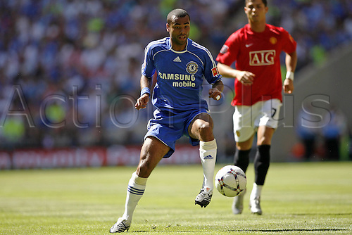 5 August 2007: Chelsea defender Ashley Cole with the ball during The FA Community Shield played between Chelsea and Man Utd at Wembley Stadium. The game finished 1-1, with Man Utd winning the penalty shoot-out 3-0. Photo: Glyn Kirk/Actionplus....070805 football soccer player