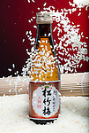 Sake bottle with a shower of rice