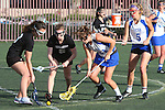 Santa Barbara, CA 02/18/12 - Katie Mitchell (UCSB #21), Elise Becker (Washington #5), Skylar Brown (UCSB #5) and Kristin Branton (Washington #3) in action during the UCSB-Washington matchup at the 2012 Santa Barbara Shootout.  UCSB defeated Washington
