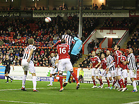 Jamie Langfield punches clear under pressure from Lee Mair in the Aberdeen v St Mirren Scottish Communities League Cup match played at Pittodrie Stadium, Aberdeen on 30.10.12.