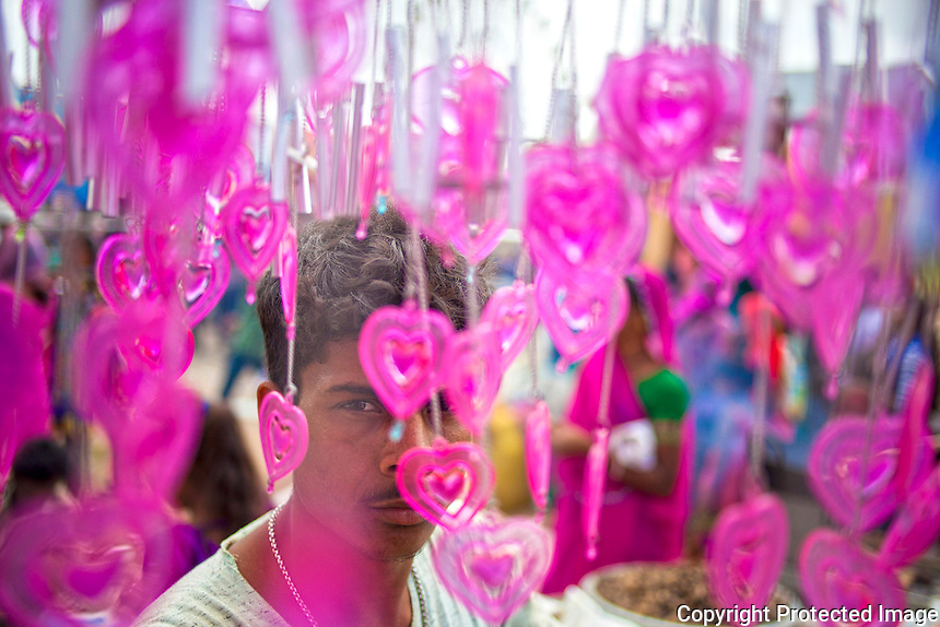 6 Sept 2016 - Tarnetar , INDIA.<br /> A young vendor sells Heart shaped Door Hangings.<br /> <br /> (Subhash Sharma for The National)
