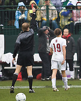 Stanford forward Kelley O'Hara (19) leaves the field after receiving a red card ejection from referee Corey Rockwell. North Carolina defeated Stanford 1-0 to win the 2009 NCAA Women's College Cup at the Aggie Soccer Stadium in College Station, TX on December 6, 2009.