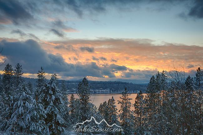 Idaho, North, Kootenai County, Coeur D'Alene. Lake Coeur d'Alene under a winter sunset.