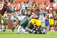Landover, MD - August 16, 2018: Washington Redskins running back Martez is tackled by several New York Jets defenders during the preseason game between New York Jets and Washington Redskins at FedEx Field in Landover, MD.   (Photo by Elliott Brown/Media Images International)