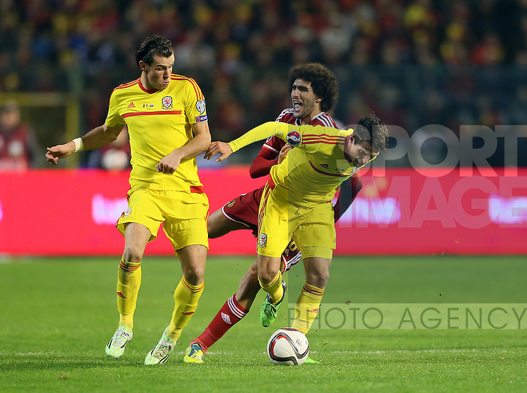 Belgium's Marouane Fellaini tussles with Wales' Gareth Bale and Joe Allen<br /> <br /> - European Qualifier - Belgium vs Wales- Heysel Stadium - Brussels - Belgium - 16th November 2014  - Picture David Klein/Sportimage