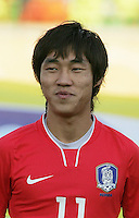 South Korea's Jung Jin Seo (11) stands on the field before the FIFA Under 20 World Cup Quarter-final match between Ghana and South Korea at the Mubarak Stadium  in Suez, Egypt, on October 09, 2009.