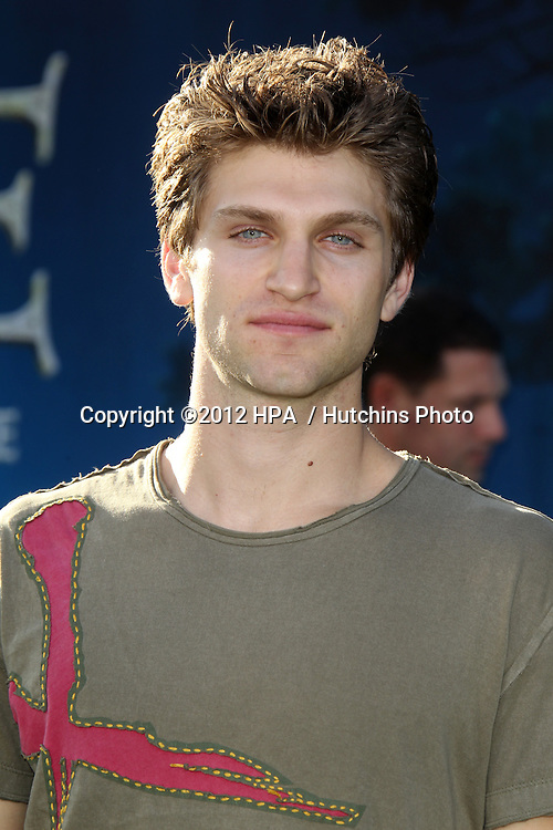 """LOS ANGELES - JUN 18:  Keegan Allen arrives at the """"Brave"""" LAFF Premiere at Dolby Theatre on June 18, 2012 in Los Angeles, CA"""