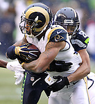 St. Louis Rams Trumaine Johnson (21) is tackled by Seattle Seahawks wide receiver Doug Baldwin (89) after intercepting a pass intended wide receiver Tyler Lockett at CenturyLink Field in Seattle, Washington on December 27, 2015.  The Rams beat the Seahawks 23-17.      ©2015. Jim Bryant Photo. All Rights Reserved