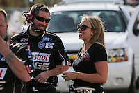 Apr. 5, 2013; Las Vegas, NV, USA: NHRA top fuel dragster driver Brittany Force (right) with crew member during qualifying for the Summitracing.com Nationals at the Strip at Las Vegas Motor Speedway. Mandatory Credit: Mark J. Rebilas-