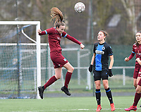 20200208 – BRUGGE, BELGIUM : Genk's Sari Kees pictured with the header in front of watching Club Brugge's Charlotte Laridon during a women soccer game between Dames Club Brugge and KRC Genk Ladies on the 15 th matchday of the Belgian Superleague season 2019-2020 , the Belgian women's football  top division , saturday 08 th February 2020 at the Jan Breydelstadium – terrain 4  in Brugge  , Belgium  .  PHOTO SPORTPIX.BE | DAVID CATRY