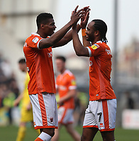 Blackpool's Michael Nottingham and Nathan Delfouneso celebrate at the final whistle<br /> <br /> Photographer Stephen White/CameraSport<br /> <br /> The EFL Sky Bet League One - Blackpool v Fleetwood Town - Monday 22nd April 2019 - Bloomfield Road - Blackpool<br /> <br /> World Copyright © 2019 CameraSport. All rights reserved. 43 Linden Ave. Countesthorpe. Leicester. England. LE8 5PG - Tel: +44 (0) 116 277 4147 - admin@camerasport.com - www.camerasport.com
