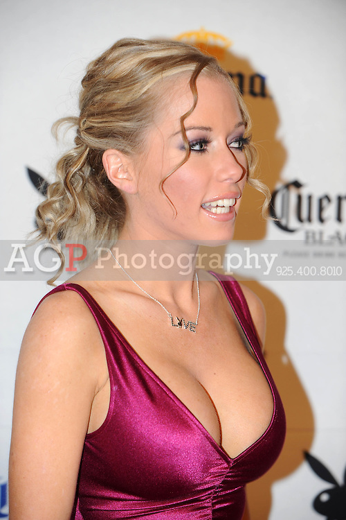 "Kendra Wilkinson, star of ""The Girls Next Door"" poses on the red carpet at Playboy's ninth annual ""Super Saturday Night""  party in at Playboy's Desert Oasis and Resort in Chandler, Arizona Saturday February 2, 2008.  (Photo by Alan Greth)"