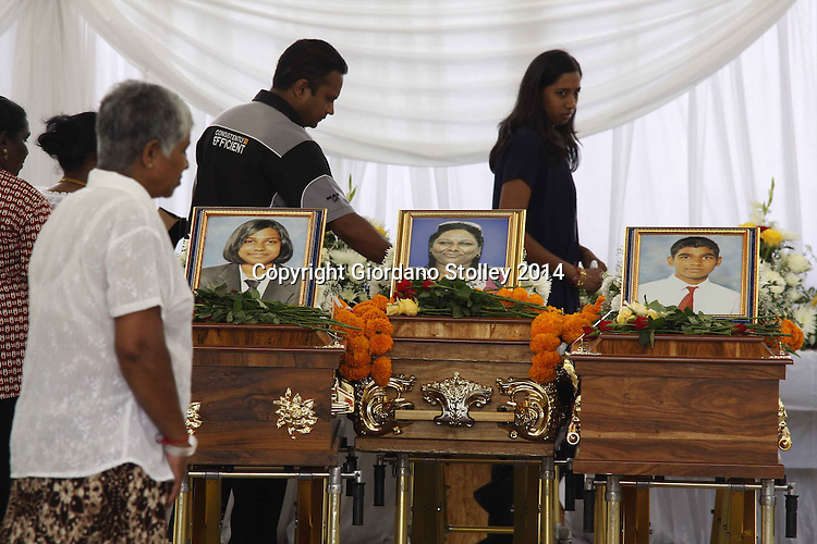 DURBAN - 4 March 2014 - Mourners pay their last respects to Melarisa Kandasamy (left picture), Mala Kandasamy and Megandren Kandasamy at their funeral in Chatsworth. Rajan Kandasamy, Mala's husband and the father of her two children, is lleged to have beaten them to death in their home using a gada --  a traditional Indian mace carried by the Hindu god Hanuman. Picture: Allied Picture Press/APP