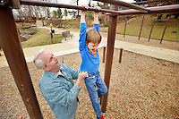 STAFF PHOTO BEN GOFF  @NWABenGoff -- 12/26/14 Dale Vickers of Nash, Texas helps his grandson Truman Vickers, 5, of Centerton climb on the outdoor exercise station while visiting Horsebarn Trailhead Park in Rogers with their family on Friday Dec. 26, 2014.