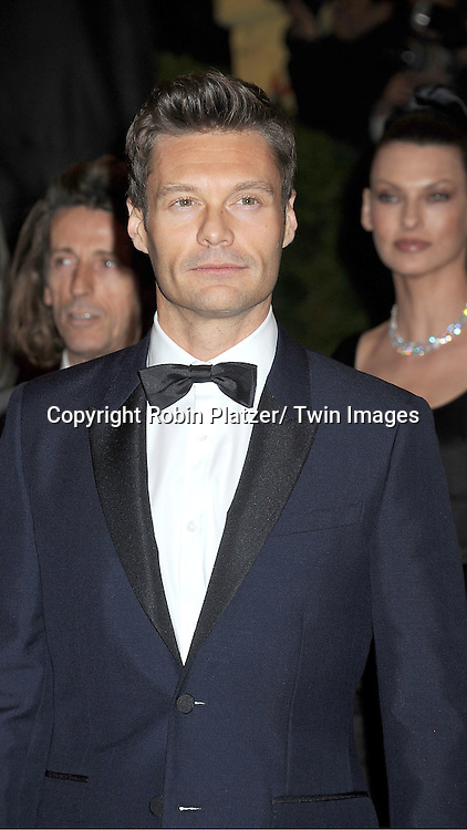 "Ryan Seacrest attends the Costume Institute Gala Benefit celebrating ""Schiaparelli and Prada: Impossible Conversations"".an exhibition at the Metropolitan Museum of Art in New York City on May 7, 2012."