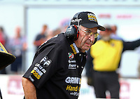Aug 15, 2014; Brainerd, MN, USA; NHRA funny car driver team owner Jim Dunn during qualifying for the Lucas Oil Nationals at Brainerd International Raceway. Mandatory Credit: Mark J. Rebilas-