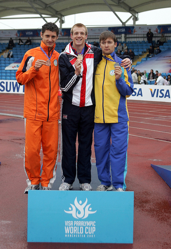 Photo: Paul Thomas..VISA Paralympic World Cup 2007. Athletics. 13/05/2007. .(lt to rt) Roman Pavlyk of Ukraine, Ben Rushgrove of Great Britain and Audrey Zhyltsov of Ukraine with their medals in the men's T36 100m.