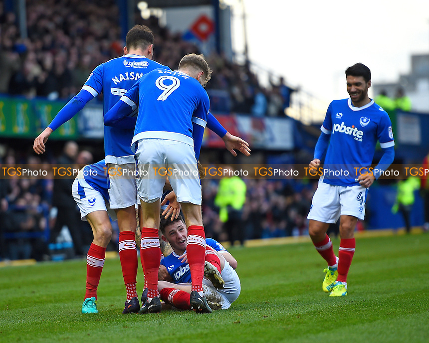 Conor Chaplin of Portsmouth (on ground) is mobbed by his team mates after scoring the first goal of the match during Portsmouth vs Leyton Orient, Sky Bet EFL League 2 Football at Fratton Park on 14th January 2017