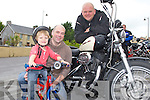 YOUNG BIKER: Ri?on Comerford with dad Brendan Comerford and Kieran Lawlor enjoying the bikes at the Charity Bike Run in aid of Cystic Fibrosis at the Mid Western Regional Hospital at Herbert's bar, Kilflynn on Sunday.