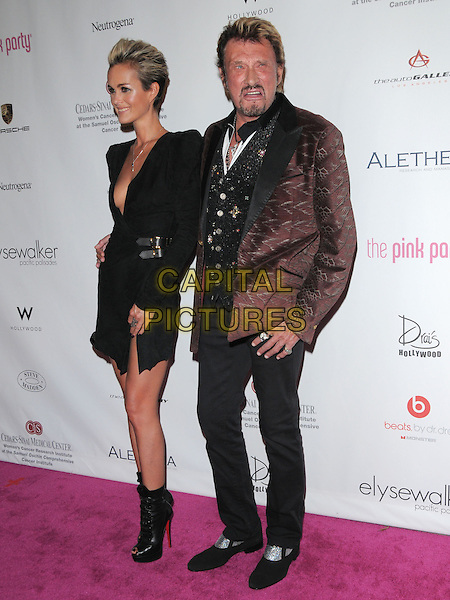 LAETICIA HALLYDAY & JOHNNY HALLYDAY .at 6th Annual Pink Party held at Drai's at The W Hotel in Hollywood, California, USA, September 25th 2010..full length married couple husband wife black dress shoulder pads long sleeve buckles christian louboutin  waistcoat suit red jacket trousers peep toe ankle boots platform lace-up low cut v-neck plunging neckline                                   .CAP/RKE/DVS.©DVS/RockinExposures/Capital Pictures.