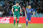 Getafe's Alvaro Vazquez (r) and Sociedad Deportiva Eibar's Adrian Gonzalez during La Liga match. March 18,2016. (ALTERPHOTOS/Acero)
