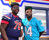 MIAMI, FL - SEPTEMBER 20: Stephen Gordon and Miami Dolphins Wide Receiver (#14) Jarvis Landry surprise the Miramar Patriots varsity football team prior to the teamís practice as part of the 4 Downs for Finance financial literacy program sponsored by BankUnited. Landry share his thoughts on the importance of financial literacy at Miramar High School Media Center on September 20, 2016 in Miramar, Florida. Credit: MPI10 / MediaPunch