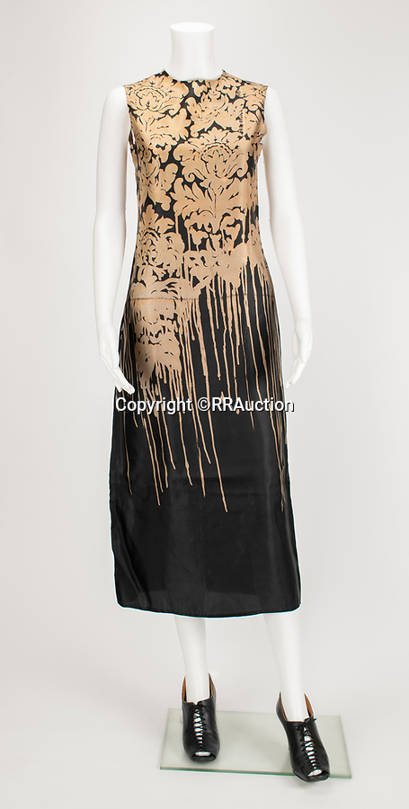 """BNPS.co.uk (01202 558833)<br /> Pic: RRAuction/BNPS<br /> <br /> Pictured:  """"Highland Rape"""" Black and Gold Dripping William Morris Print Dress AW 1995 has an estimate of $85,000<br /> <br /> A vast archive of items relating to British fashion designer Alexander McQueen have emerged for sale for over £1m.<br /> <br /> The enormous collection has been amassed by one of his personal friends -Ruti Danan who worked worked for the late icon for two years between 1994 and 1996.<br /> <br /> During that period she amassed a treasure trove of items including items of clothing, behind-the-scene photographs and sketches of new designs.<br /> <br /> She has kept the collection for over two decades but has now decided the time is right to part with it for the first time.<br /> <br /> There are an incredible 74 lots set to go under the hammer at RR Auction of Boston, Massachusetts."""