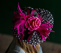 LOUISVILLE, KY - MAY 05: A woman wears her best pink hat on Kentucky Oaks Day at Churchill Downs on May 5, 2017 in Louisville, Kentucky. (Photo by Scott Serio/Eclipse Sportswire/Getty Images)