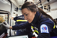 Switzerland. Canton Ticino. Lugano. Paramedics team working for the Croce Verde Lugano. A senior woman is brought by ambulance to hospital for medical examinations. The elderly woman is suffering from drug poisoning for taking by mistake an overdose of prescribed drugs. The paramedics wear blue uniforms and medical gloves. The woman is a volunteer specifically trained in emergency rescue. The Croce Verde Lugano is a private organization which ensure health safety by addressing different emergencies services and rescue services. Volunteering is generally considered an altruistic activity where an individual provides services for no financial or social gain to benefit another person, group or organization. Volunteering is also renowned for skill development and is often intended to promote goodness or to improve human quality of life. Medical gloves are made of different polymers including latex, nitrile rubber, polyvinyl chloride and neoprene. 14.01.2018 © 2018 Didier Ruef