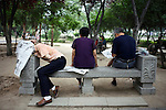 XIAN, CHINA - JUNE 3: An unidentified man has fallen asleep on a park bench after reading a newspaper on June 3, 2007 in central Xian, China. Many retired people come to the park to exercise, usually early in the morning. The city has about 3,3 million inhabitants and is the capital of Shaanxi province in China. It was the eastern terminus for the Silk Road and the location for the Terracotta Army during the Qin Dynasty. Its history dates back more than 3,100 years. (Photo by Per-Anders Pettersson)..