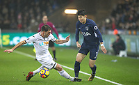 Son Heung-Min of Spurs & Angel Rangel of Swansea City  during the Premier League match between Swansea City and Tottenham Hotspur at the Liberty Stadium, Swansea, Wales on 2 January 2018. Photo by Mark Hawkins / PRiME Media Images.