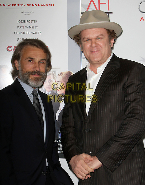 "Christoph Waltz & John C. Reilly.AFI Fest 2011  Premiere Of ""Carnage"" Held At Grauman's Chinese Theatre, Hollywood, California, USA..November 5th, 2011.half length black suit beard facial hair blue shirt hand in pocket hat beige brown.CAP/ADM/KB.©Kevan Brooks/AdMedia/Capital Pictures."