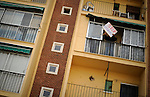 SPAIN, Madrid : A man holds a placard reading 'Stop evictions' from the balcony of Vicente Torres's apartment in Madrid on April 18, 2012. Vicente Torres, 73, who is severy ill and underwent a recent heart surgery, faces an eviction from his house. Eviction procedures in Spanish courts for unpaid mortgages and rent hit a record of 58,241 in 2011, a 21.2 percent rise over the previous year. Evictions have soared in Spain since the collapse of a property bubble in 2008 that triggered the country's economic crisis. (c) Pedro ARMESTRE