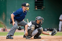 Catcher Rene Garcia (5) of the Greeneville Astros frames a pitch for home plate umpire Ryan Karle at Bowen Field in Bluefield, WV, Sunday July 6, 2008. (Photo by Brian Westerholt / Four Seam Images)