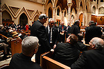 Mayor Rahm Emanuel greets priests from Chicago and around the nation and world arriving for the mass ahead of the installation ceremony of the Archbishop-elect of Chicago, Blase Cupich, at Holy Name Cathedral in Chicago, Illinois on November 18, 2014.  Cupich is the ninth Archbishop of Chicago and succeeds Cardinal Francis George.