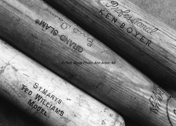 B&W closeup of three wood baseball bats with names: Ted Williams, Eric Davis, Ken Boyer