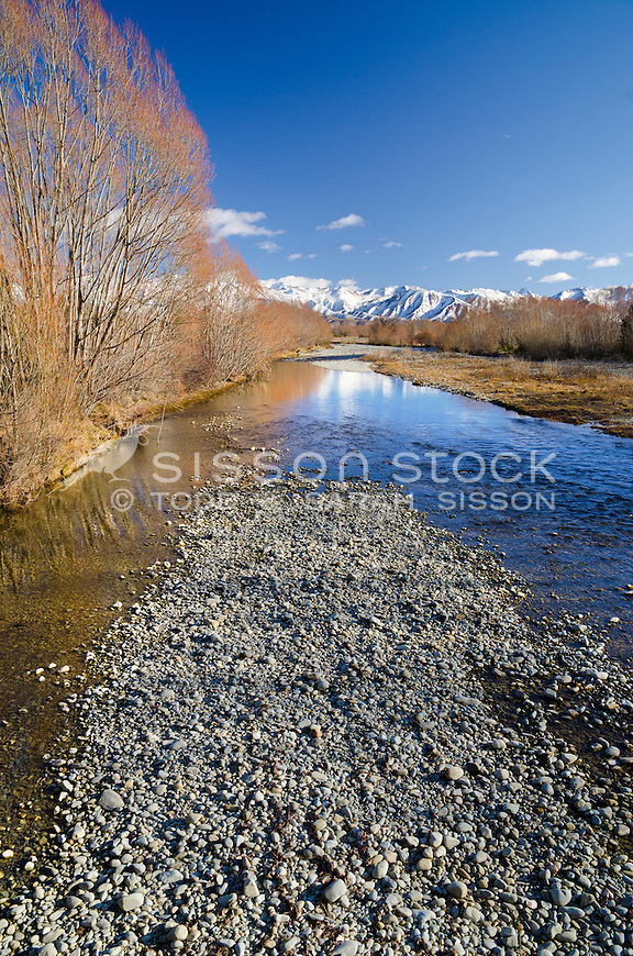 Snowy mountains reflected in the Twizel river. Sunny winter's day. South Island,New Zealand - stock photo, canvas, fine art print