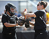 Nicoletta Cuccio #10, Adelphi catcher, left, and pitcher Lindsay Mapes #11 slap hands after the bottom of the third inning of Game 2 of the NCAA Division II East Super Regional against Southern New Hampshire University at Adelphi University on Thursday, May 12, 2016. Adelphi won 4-1 to sweep the best-of-three series.